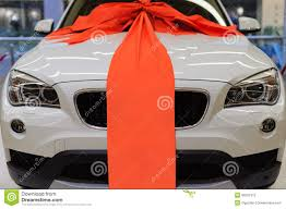 car ribbon brand new white present car with large ribbon decoration stock