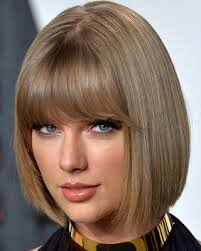 graduated bob with fringe hairstyles taylor swift with short chin length bob and full blunt bangs