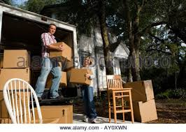 Chair Boxes Moving Men Unloading Chair From Moving Van Stock Photo Royalty Free