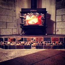river rock and slate hearth pad wood burning stove wood glow