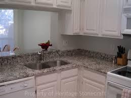 decorating white kitchen cabinet with bianco antico granite