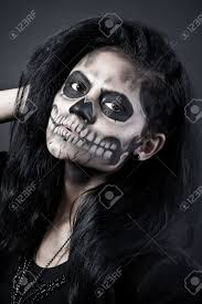 halloween skull background young woman in day of the dead mask skull face art halloween