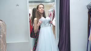beautiful brunette wearing in pink wedding dress in classic