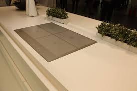 kitchen hood lights gray solid surface countertop on white island black pendant lights