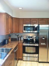 stainless steel and black appliances with waypoint maple 451s