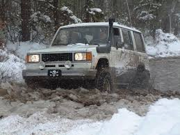 isuzu trooper mudding it in the snow offroad prepping camping