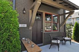 Awning Doors Cottage Front Door With Fence By Signature Homes Zillow Digs