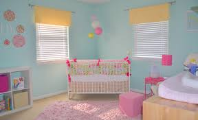 wall paint idea for a nursery room a white baby crib a wooden baby