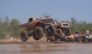 mudding truck monster trucks jumping into mud louisiana mudfest autoevolution