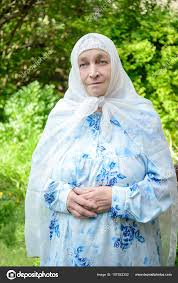 clothing for elderly an elderly muslim woman in bright clothing stock photo
