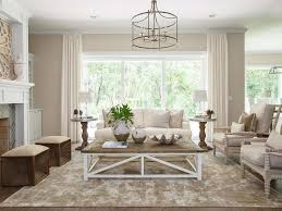 rectangular wood white area rug chandelier lighting coffee table