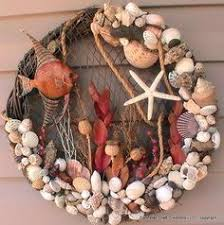 wreaths from dollar store silver spray paint and sea decor and