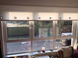 large 3 panel window opens fully or partially includes blind