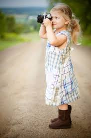 Cute small blonde girl posing with camera Free stock photos in jpg