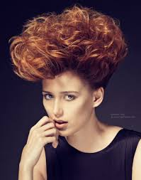 short copper hair with highlights messy and lifted up above the head