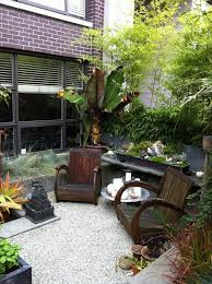 cozy garden sitting area landscape tropical with containers wicker