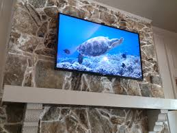 three misconceptions about mounting your tv above the fireplace