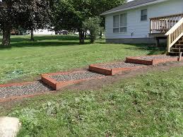Building A Backyard Garden by Building Steps On A Slope
