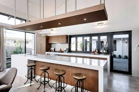 wonderful breakfast space with round stools on a big kitchen