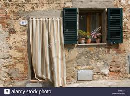 typical tuscan house in the town of monitisi with a curatined