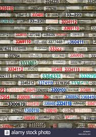 layers of telephone numbers stickers on window blinds of a local
