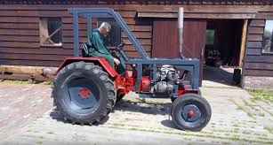 suzuki motorcycle old suzuki motorcycle powers a tractor in the netherlands