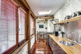 cuisine dans loft kitchen in inox and wood in a parisian loft open to the dining