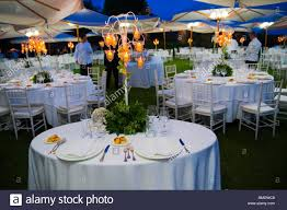 outdoor wedding dinner table place setting at night stock photo