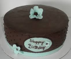 chocolate ganache cake decoration sweet t u0027s cake design light blue flowers w brown centers