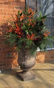 containers and urns with fresh greens are the perfect solution for