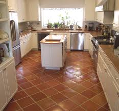 kitchen with mexican tile installed on a diagonal and pulled for