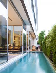87dch house by ong u0026ong khoo guo jie lap pool on the side of the