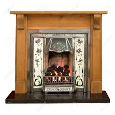 victorian style tiled fireplace with pine surround stock photo