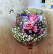 Tall Metal Vases For Wedding Centerpieces by Rose Floating In Big Wine Glass Diy Wedding Centerpiece Idea