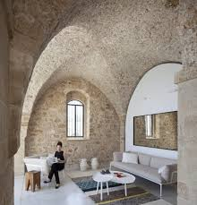 old stone wall living room modern with cushion back sofas and