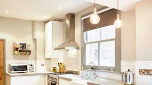 White Laminate Kitchen Cabinets Cement Counters Dark Kitchen Cabinet Grey Iron Ceiling Lamp Window