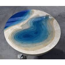 aquatic coffee tables made by merging natural stone and resin