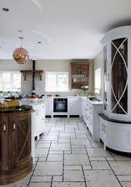 beautiful kitchen design with unique floor tiles wooden round