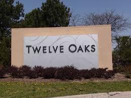 cus den twelve oaks mall store details