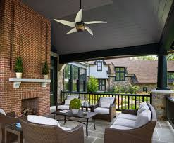 red brick fireplace porch traditional with outdoor potted plants