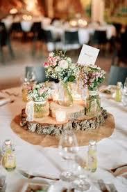 wedding table decorations a relaxed garden soiree wedding in kiama tree trunks wedding