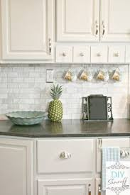white backsplash for kitchen http manufacturedhomerepairtips com easybacksplashideas php