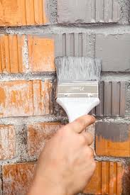 orange brick wall painted with grey color stock photo image