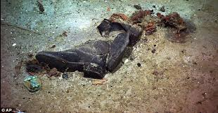 pictures of a titanic 100th anniversary shoes and coat found at wreck site