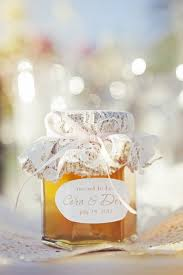 honey jar favors lace covered personalized jar of honey as wedding favor photo by
