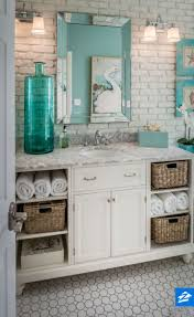 322 best beautiful bathrooms images on pinterest bathroom ideas soften up an industrial looking bathroom with cozy touches like wicker baskets and distressed paintings