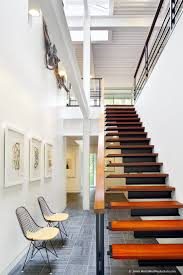 Stairs In House by Floating Wood Staircase In House Redesign By Tonic Design