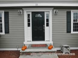 exterior design grey hardie plank siding and white garage door
