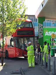 woman rushed to hospital after london bus crashes into asda