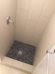 tile picture gallery showers floors walls sliced charcoal black pebble tile shower floor pebble tile shop